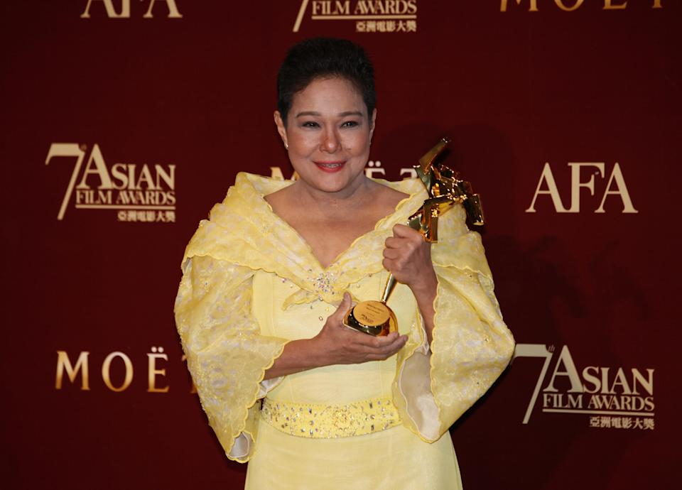 "The Philippines actress Nora Aunor poses with her trophy after winning the  Best Actress Award of her movie ""Thy Womb"" at the Asian Film Awards as part of the 37th Hong Kong International Film Festival in Hong Kong Monday, March. 18, 2013.  (AP Photo/Kin Cheung)"