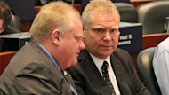 Toronto Mayor Rob Ford, left, and his brother, Coun. Doug Ford, are set to host a backyard barbecue for thousands of Torontonians.