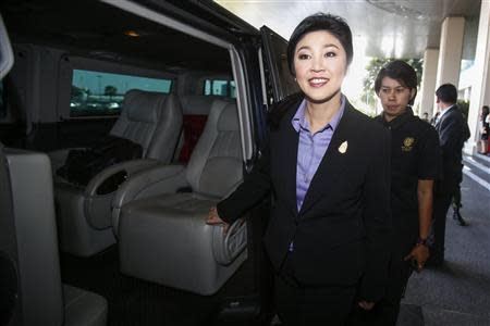 Thailand's Prime Minister Yingluck Shinawatra leaves the Government Complex after a meeting with the Election Commission in Bangkok