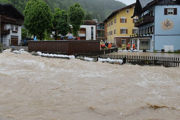 Firefighters pump water into the flooded river Lofer in Lofer in the Austrian province of Salzburg, Sunday, June. 2, 2013. Heavy rainfalls cause flooding along rivers and lakes in Germany, Austria, Sw