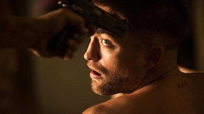 """This image released by A24 Films shows Robert Pattinson in a scene from """"The Rover."""" (AP Photo/A24 Films, Matt Nettheim)"""