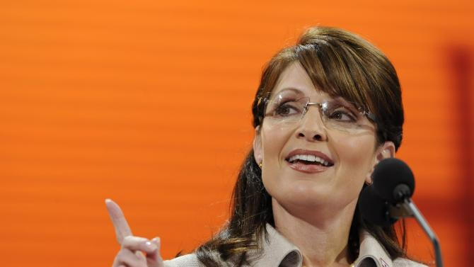 """FILE - In this Sept. 3, 2008, file photo, Republican vice presidential candidate, Alaska Gov. Sarah Palin, speaks during the Republican National Convention in St. Paul, Minn. Republicans heading to their 2012 party convention in Tampa are eager to hear an earful about the shortcomings of President Barack Obama's record, the woeful U.S. economy and the competing visions of the two presidential candidates. They aren't looking for compromise, which most Americans say is necessary to get the nation on track. The delegates hear rhetoric that is brutal, vitriolic and far from conciliatory. Some lines from both conventions are memorable. Comparing her mayoral experience in Wasilla to that of Democratic nominee Barack Obama, Palin said, """"I guess a small-town mayor is sort of like a community organizer, expect that you have actual responsibilities."""" (AP Photo/Susan Walsh, File)"""