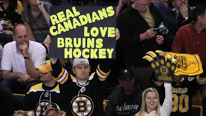 Boston Bruins fans hold a sign during the second period of Game 6 of the NHL hockey Stanley Cup Finals between the Vancouver Canucks and the Bruins in Boston on Monday, June 13, 2011. (AP Photo/The Canadian Press, Jonathan Hayward)