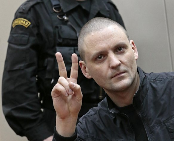 Russian opposition leader Sergei Udaltsov gestures in a courtroom in Moscow, Russia, Saturday, Feb. 9, 2013. Udaltsov, a top Russian opposition figure, has been placed under house arrest for two months, a move that also bans him from using most forms of communication, including the Internet, telephone and mail. A Moscow court imposed the restrictions Saturday on Udaltsov who faces charges in connection with a protest in 2011 that ended in clashes with police and for allegedly plotting to conduct mass disorder which according to prosecutors was aimed at overthrowing the government. (AP Photo/Mikhail Metzel)