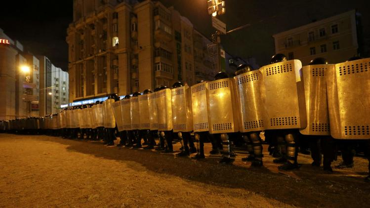Riot police form a cordon near Independence Square in Kiev