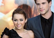 Actress and singer Miley Cyrus and actor Liam Hemsworth at the premiere of &quot;The Last Song&quot; in Hollywood in 2010. Hemsworth has proposed to girlfriend Cyrus, with the pair tweeting their engagement on Thursday