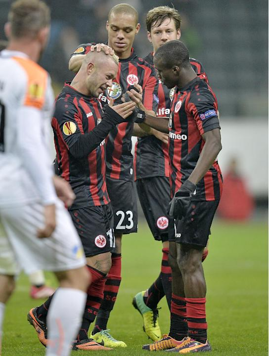 Frankfurt's Stephan Schroeck of the Philippines, left, celebrates his goal with second scorer Frankfurt's Constant Djakpa of Ivory Coast, right, during the Europa League Group F soccer match b