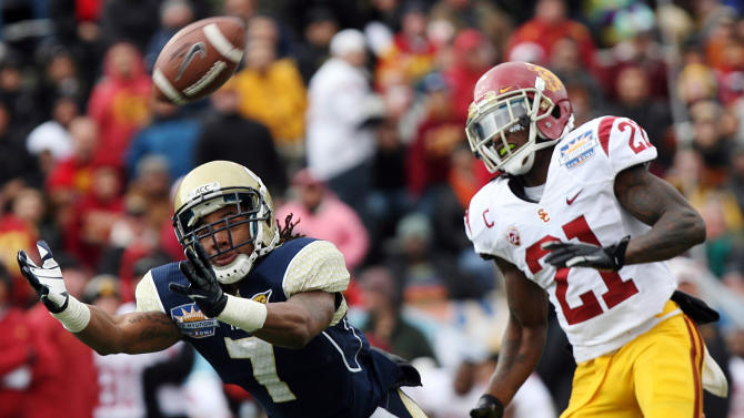 Georgia Tech's B.J. Bostic (7) dives for a pass while defended by Southern California's Nickell Robey during the Sun Bowl NCAA college football game, Monday, Dec. 31, 2012, in El Paso, Texas. (AP Photo/Mark Lambie)