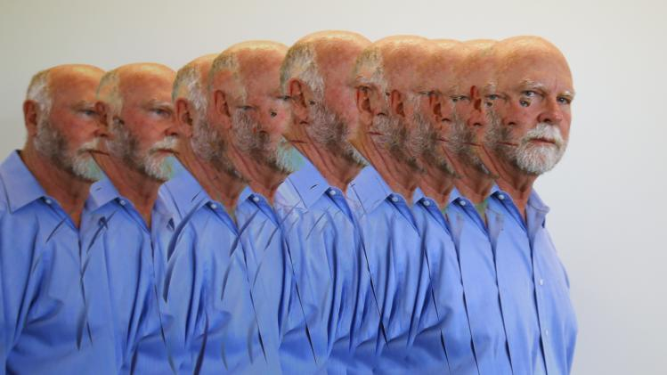 Genetic researcher Craig Venter is shown with a multiple camera exposure in his office in La Jolla