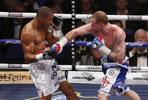 George Groves of Britain, right, fights against Noe Gonzalez of Uruguay during their WBA Inter-Continental super middleweight championship boxing match at O2 Arena in London, Saturday, May 25, 2013