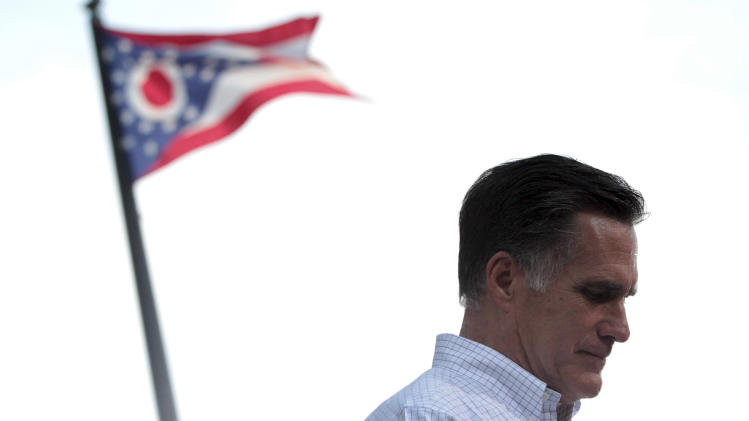 The Ohio state flag flies in the background while Republican presidential candidate, former Massachusetts Gov. Mitt Romney speaks during a campaign event at the Ross County Court House, Tuesday, Aug. 14, 2012 in Chillicothe, Ohio.  (AP Photo/Mary Altaffer)