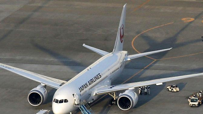 A Japan Airlines 787, from which fuel spilled at Boston's Logan International Airport last Tuesday, sits on the tarmac at Narita Airport in Narita, east of Tokyo, Sunday, Jan. 13, 2012. Narita airport officials said JAL reported a 100-liter fuel leak from a filler on the 787 during inspection following recent spate of problems. (AP Photo/Kyodo News) JAPAN OUT, MANDATORY CREDIT, NO LICENSING IN CHINA, HONG KONG, JAPAN, SOUTH KOREA AND FRANCE