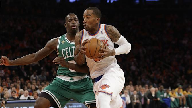 New York Knicks guard J.R. Smith, right, drives past Boston Celtics forward Jeff Green (8) during the first half of Game 1 in the first round of the NBA basketball playoffs at Madison Square Garden in New York, Saturday, April 20, 2013.  (AP Photo/Kathy Willens)