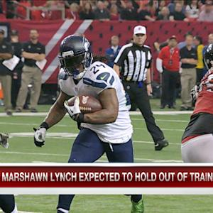 Why is Seattle Seahawks running back Marshawn Lynch holding out of training camp?