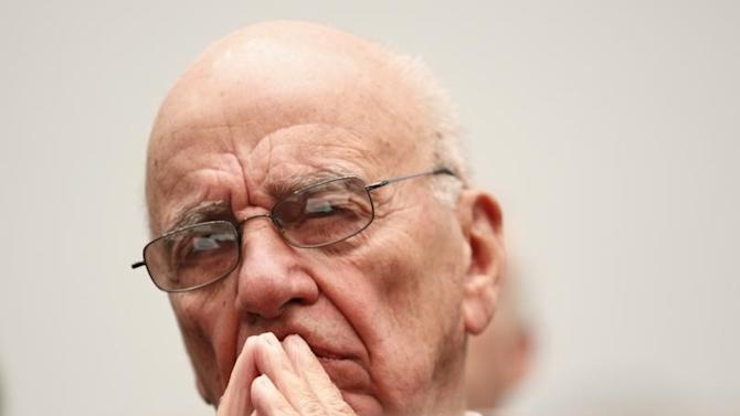 News Corporation CEO Rupert Murdoch waits to testify before the House Immigration, Citizenship, Refugees, Border Security and International Law Subcommittee on Capitol Hill in Washington