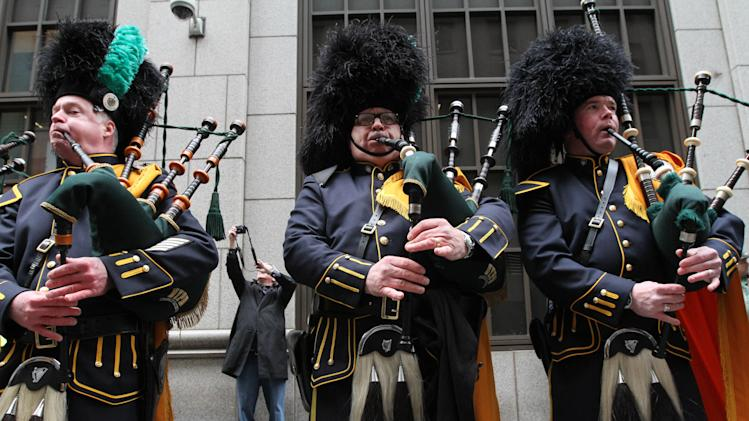 John Sanford, foreground center, and other members of the New York City Police Department Pipes and Drums practice before the start of the St. Patrick's Day Parade, Saturday March 16, 2013 in New York. (AP Photo/Tina Fineberg)
