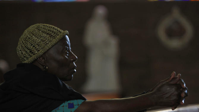 "A worshipper prays at the Regina Mundi Church in Soweto, South Africa, prior to early morning Mass, Tuesday, Dec 11 2012. Calls for prayer have been made for former president Nelson Mandela who was admitted to the 1 Military Hospital in Pretoria at the weekend. South Africa's presidency says former President Nelson Mandela is suffering from a recurring lung infection and is responding to treatment. The statement Tuesday, Dec.  from presidential spokesman Mac Maharaj said the 94-year-old anti-apartheid icon is ""receiving appropriate treatment and he is responding to the treatment."" (AP Photo/Denis Farrell)"