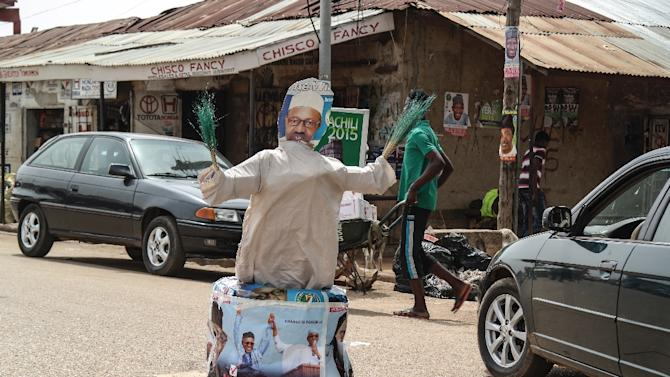 A cardboard figure of All Progressives Congress candidate Muhammadu Buhari is displayed in a street of Kaduna, Nigeria on March 27, 2015, one day before the presidential election