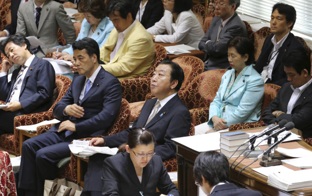 Japanese Prime Minister Yoshihiko Noda, center, accompanied by Deputy Prime Minister. a;sp om cjarge pf Spcoea; Security and Tax Reform Katsuya Okada, second left, and Finance Minister Jun Azumi, left, looks up during a lower house special committee meeting on the social security system and tax integrated reform at the Diet in Tokyo, Monday, June 25, 2012. A battle between rival blocs in Japan's ruling party escalated Monday ahead of a tax hike vote that is threatening to split the party and weaken Noda's hold on power. (AP Photo/Koji Sasahara)