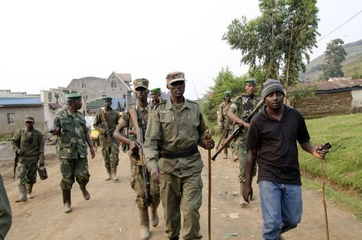 Colonel Sultani Makenga (C), head of the rebel M23 group, tours Bunagana, a town near the border in Uganda, on July 8. United Nations helicopters on Tuesday fired on rebel positions in eastern Democratic Republic of Congo after new clashes broke out there between rebel fighters and loyalist troops, officials said.
