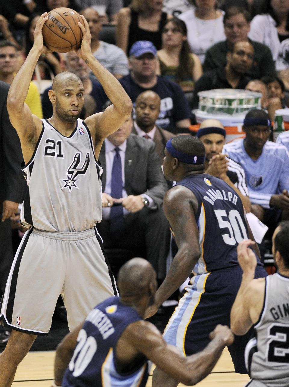 San Antonio Spurs' Tim Duncan, left, looks to pass around Memphis Grizzlies' Zach Randolph (50) during the second half of Game 1 of the Western Conference final NBA basketball playoff series on Sunday, May 19, 2013, in San Antonio. San Antonio won 105-83. (AP Photo/Darren Abate)