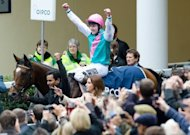 Jockey Tom Queally waves to the crowd as he rides racehorse Frankel. Frankel produced perhaps his finest performance to retain his unbeaten record with his 14th victory in the Group One Champion Stakes in what was his final race