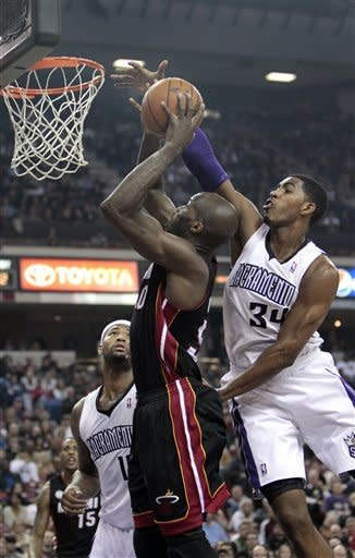 Chalmers hits 10 3-pointers as Heat rout Kings