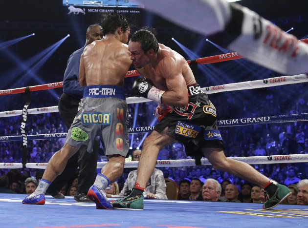 Juan Manuel Marquez, from Mexico, right, knocks out Manny Pacquiao, from the Philippines, in the sixth round of their WBO world welterweight  fight Saturday, Dec. 8, 2012, in Las Vegas. Referee Kenny