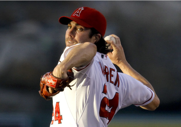 Los Angeles Angels starting pitcher Dan Haren throws to a Los Angeles Dodgers batter in the first inning of a baseball game in Anaheim, Calif., Friday, June 22, 2012. (AP Photo/Jae C. Hong)