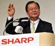 Japanese electronics giant Sharp's recently appointed president Takashi Okuda announces the company's tie-up with Taiwan's Hon Hai Precision as part of a LCD panel tie-up, as Sharp looks to reverse recent losses, at a press conference in Tokyo, on March 27. Sharp is likely to report a net loss of nearly 400 billion yen for the business year that ended in March, according to a report