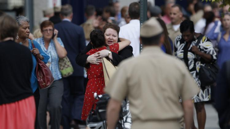 Navy Yard workers, evacuated after the shooting, are reunited with