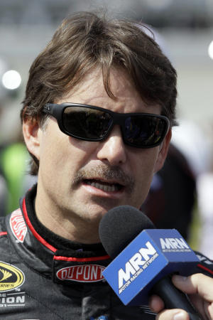Jeff Gordon talks to reporters before the NASCAR Sprint Cup Series auto race at Chicagoland Speedway in Joliet, Ill., Sunday, Sept. 16, 2012. (AP Photo/Nam Y. Huh)