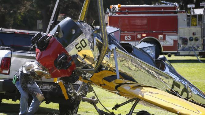Actor Harrison Ford's damaged airplane is taken away after its crash landing at Penmar Golf Course in Venice, Los Angeles