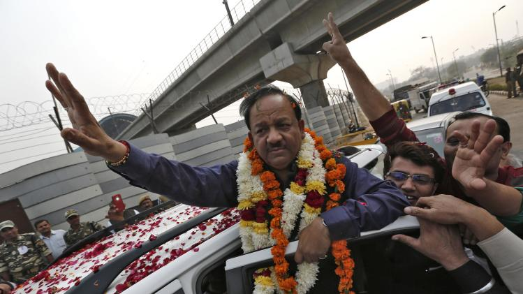 BJP candidate for Delhi CM Vardhan waves to his supporters in New Delhi