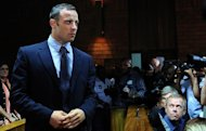 South African Paralympic icon and murder suspect Oscar Pistorius appears at court in Pretoria on February 22, 2013. Pistorius spent his first day out on bail with his family Saturday
