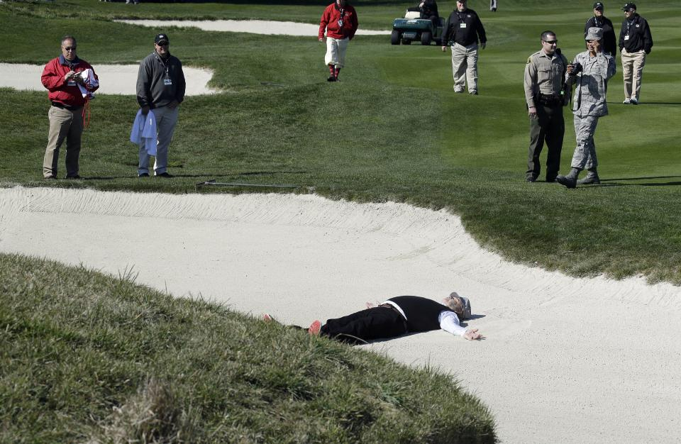 Actor Bill Murray makes an angel in a bunker on the second hole of the Pebble Beach Golf Links during the celebrity challenge event of the AT&T Pebble Beach Pro-Am golf tournament Wednesday, Feb. 6, 2013 in Pebble Beach, Calif. (AP Photo/Ben Margot)