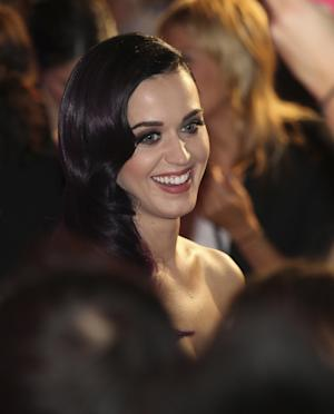 """Singer Katy Perry arrives for the Australian premiere of her movie """"Part of Me""""  in Sydney, Australia,  Saturday, June 30, 2012. (AP Photo/Rob Griffith)"""