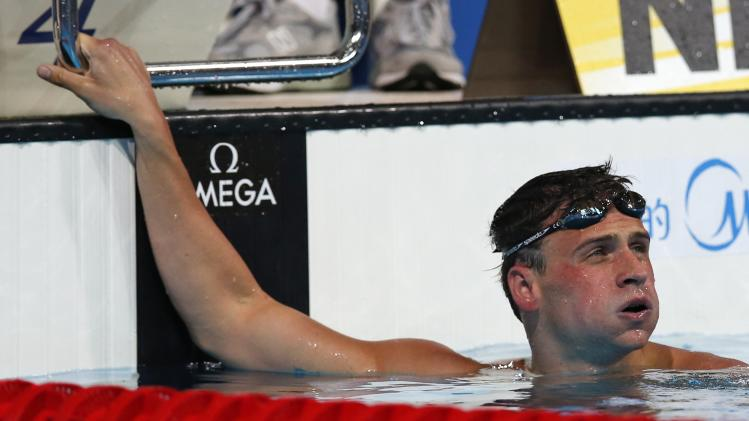 Ryan Lochte of the United States looks up after winning the gold medal in the Men's 200m individual medley final at the FINA Swimming World Championships in Barcelona, Spain, Thursday, Aug. 1, 2013. (AP Photo/Michael Sohn)