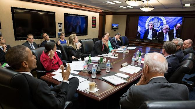 White House photograph shows US President Barack Obama (L), Vice President Joe Biden (R) and national security members in a secure video conference from the White House March 31, 2015, with Secretary of State John Kerry (on screen at left)
