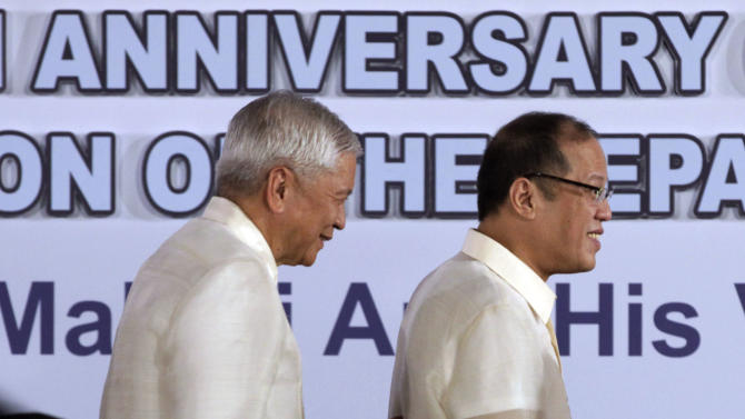 Philippine President Benigno Aquino III, right, leaves the stage followed by Secretary Albert Del Rosario after he delivers his message during the 114th Foundation of the Department of Foreign Affairs Thursday, July 26, 2012 in suburban Pasay City south of Manila, Philippines. Aquino repeated his stand that the country will continue to claim for the disputed Scarborough Shaol and for the peaceful settlement of claims in the disputed islands in South China Sea. (AP Photo/Pat Roque)