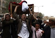 Mourners shout slogans during the funeral of a protester who was killed two days ago during clashes with security forces at the US embassy in Sanaa