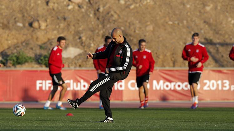 Bayern head coach Pep Guardiola of Spain kicks ball during a last training session at the Club World Cup soccer tournament in Marrakech, Morocco, Friday, Dec. 20, 2013. Bayern Munich will face Raja Casablanca in the final on Saturday, Dec. 21