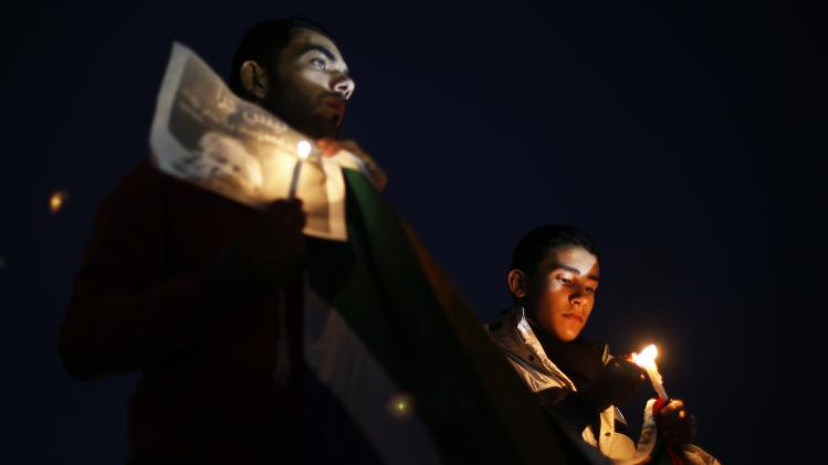 Palestinians attend a candlelight vigil in tribute of Mandela in Gaza City