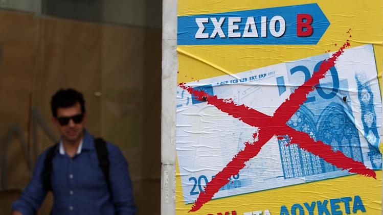 A pedestrian passes a poster reading ''Plan B, No to the padlocks, No to the Euro'',  in Athens, Wednesday, Oct. 17, 2012. Civil servants and private sector workers stage a nationwide general strike on Thursday to protest new austerity measures the government is still negotiating with the debt-ridden country's international creditors. (AP Photo/Thanassis Stavrakis)