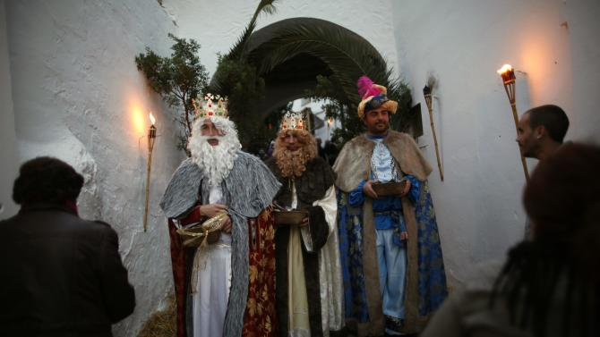 Men take part in a re-enactment of the nativity scene, in El Gastor