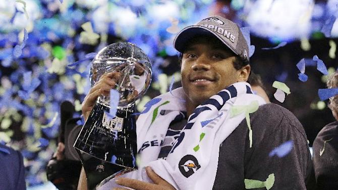 Seattle Seahawks' quarterback Russell Wilson holds the Lombardi Trophy after the NFL Super Bowl XLVIII football game Sunday, Feb. 2, 2014, in East Rutherford, N.J. The Seahawks won 43-8