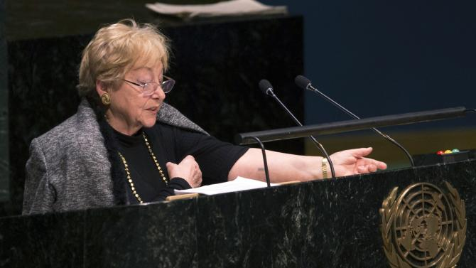 Survivor of Auschwitz concentration camp Jona Laks shows number tattoo still on her left arm, while speaking during a ceremony to mark the International Day of Commemoration in Memory of the Victims of the Holocaust at U.N. headquarters in New York