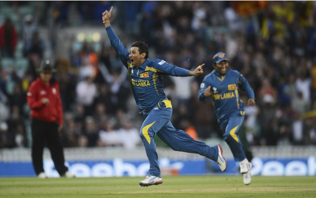 Sri Lanka's Tillakaratne celebrates after catching Australia's McKay as his team qualified for the semi finals in the ICC Champions Trophy group A match at The Oval cricket ground, London