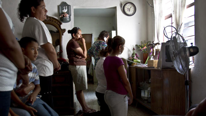 Relatives of Texas death row inmate Humberto Leal pray at a home in Guadalupe, on the outskirts of Monterrey, Mexico Thursday July 7, 2011. Relatives of Leal gathered to pray and hope that Texas governor, Rick Perry, spare the convicted murderer's life. Despite appeals from President Barack Obama and other legal and foreign policy experts, Leal was executed by lethal injection at the Texas death chamber in Huntsville for the 1994 rape and murder of a 16-year-old San Antonio girl. (AP Photo/Hans Maximo Musielik)