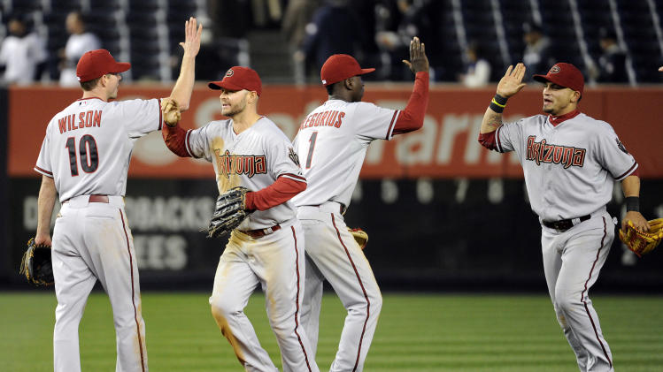 The Arizona Diamondbacks celebrate after defeating the New York Yankees 6-2 in the 12th inning of a baseball game, Thursday, April 18, 2013, at Yankee Stadium in New York. (AP Photo/Bill Kostroun)